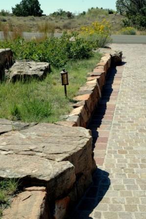 porphyry, boulders, driveway pavers, landscape lighting, driveway entry