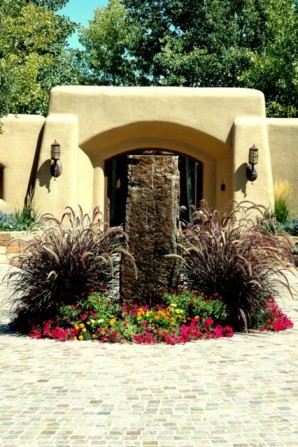 fountain, water feature, standing stone,fountain grass, annuals, pretty flowers,