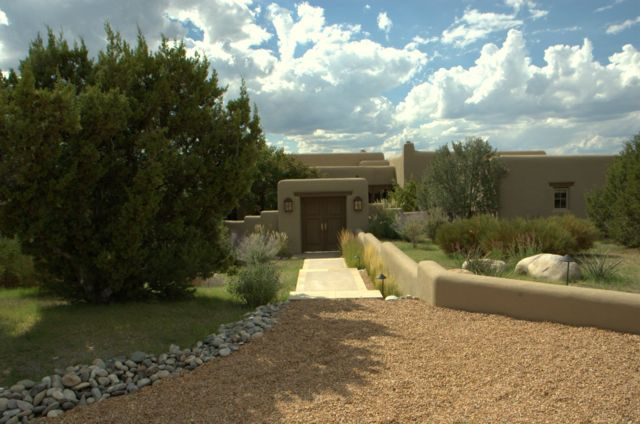 formal path, gravel driveway, ornamental grasses,