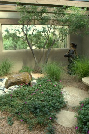 garden sculpture, fountain, gravel mulch, grasses