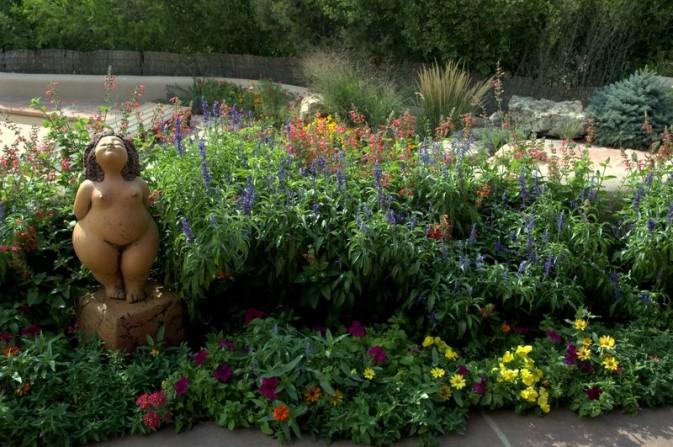 garden sculpture, colorful flowers, patio, flagstone, pool