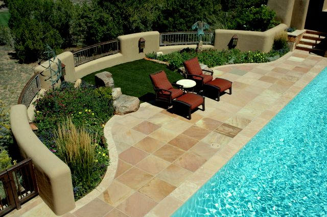 pool, pool side garden, artificial grass, ornamental grass, cut flagstone pavers, pool coping