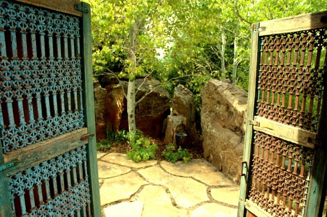 secret garden, big boulders, old doors, aspen trees, random flagstone