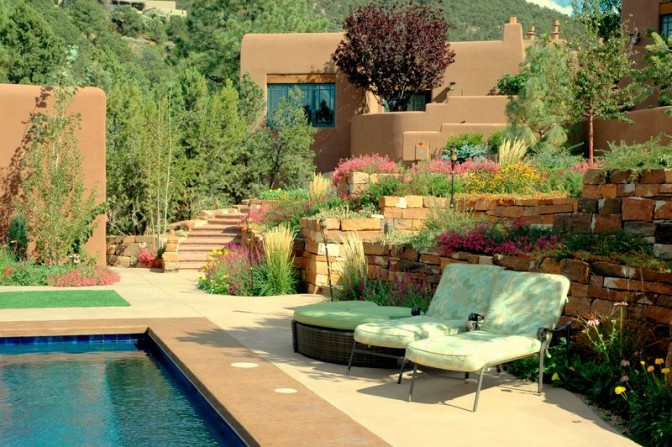 tiki torch, terrace, terraced walls, poolside garden, pool, tumbling flowers, southwestern style garden, stone work, natural stone, rock work, stone walls, masonry walls