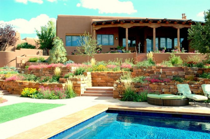 terrace, terraced walls, poolside garden, pool, tumbling flowers, southwestern style garden, stone work, natural stone, rock work, stone walls, masonry walls